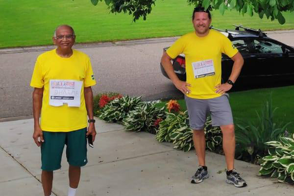 Two attendees participating in the fun run together